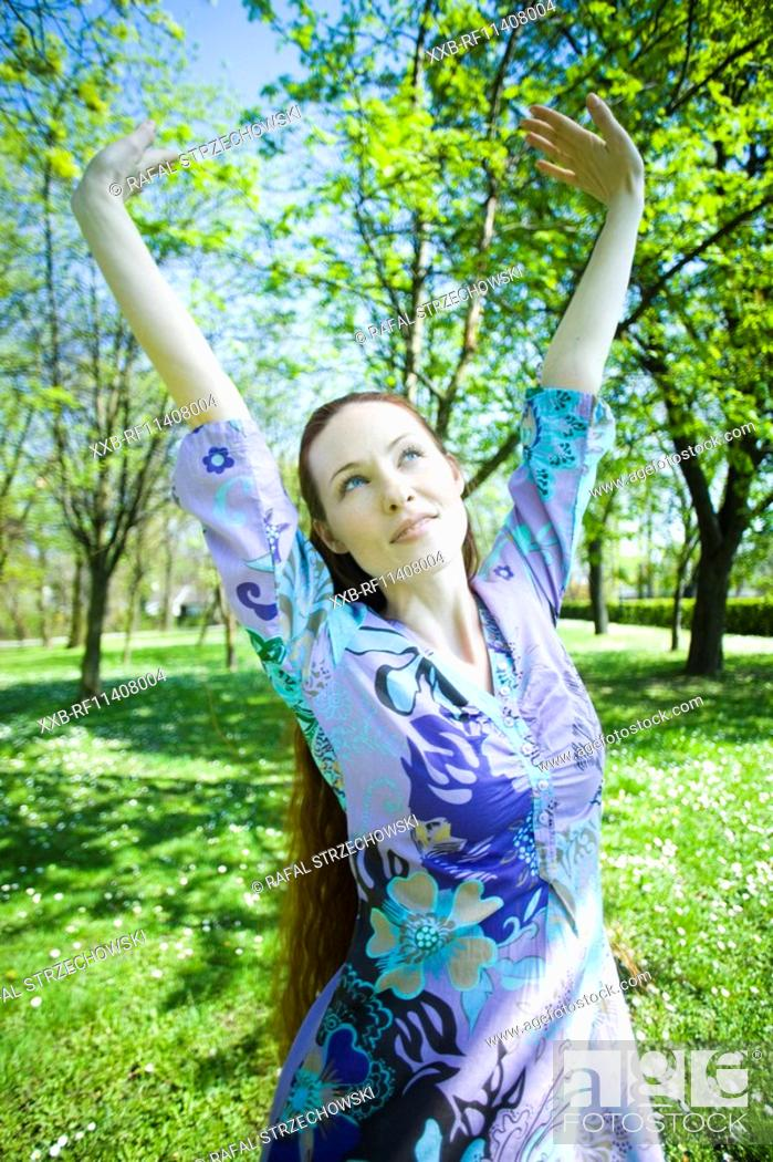 Stock Photo: Woman walking in the park.
