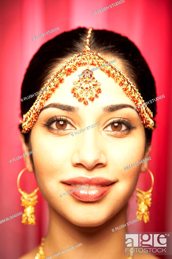 Stock Photo: Close up of Indian woman smiling.