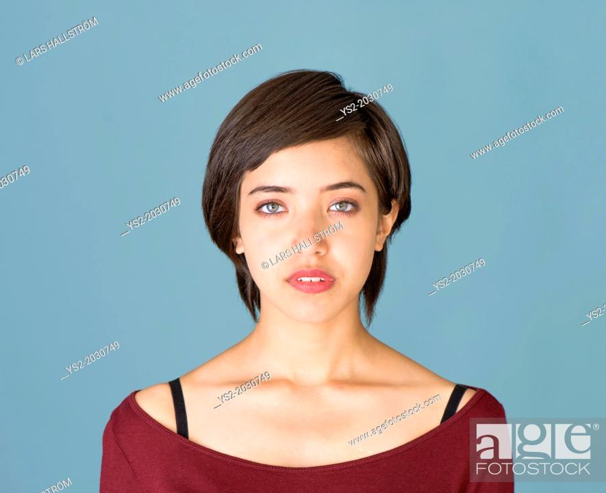 Stock Photo: Portrait of confident and natural young multiracial woman.	1015.
