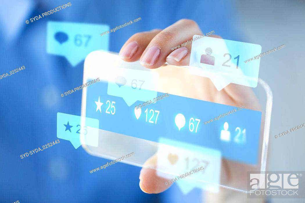Stock Photo: hand with social media icons on smartphone.