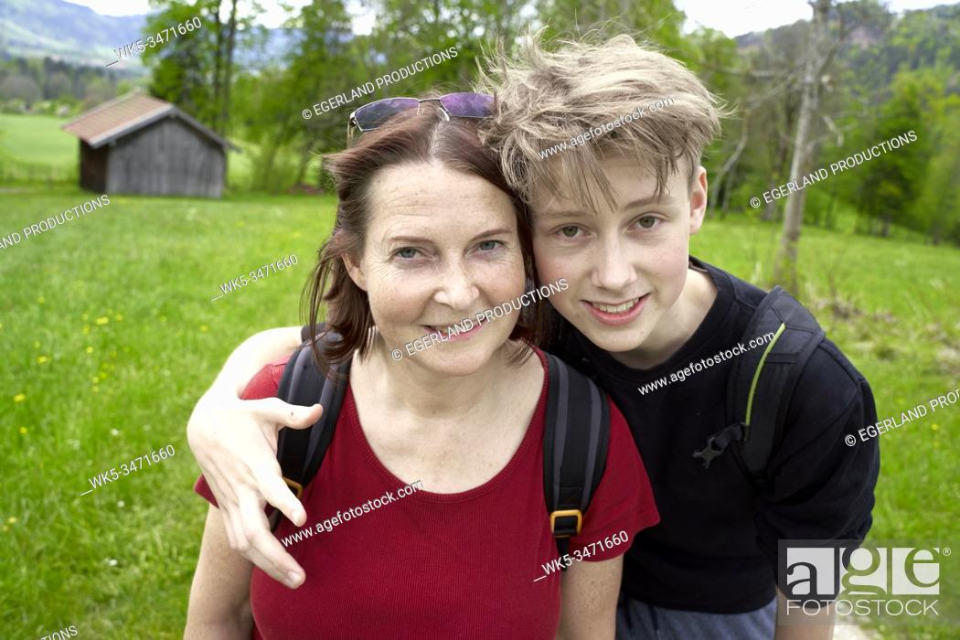 Stock Photo: Mature woman and teenager son in the countryside. Bad Tölz, Upper bavaria, Germany.