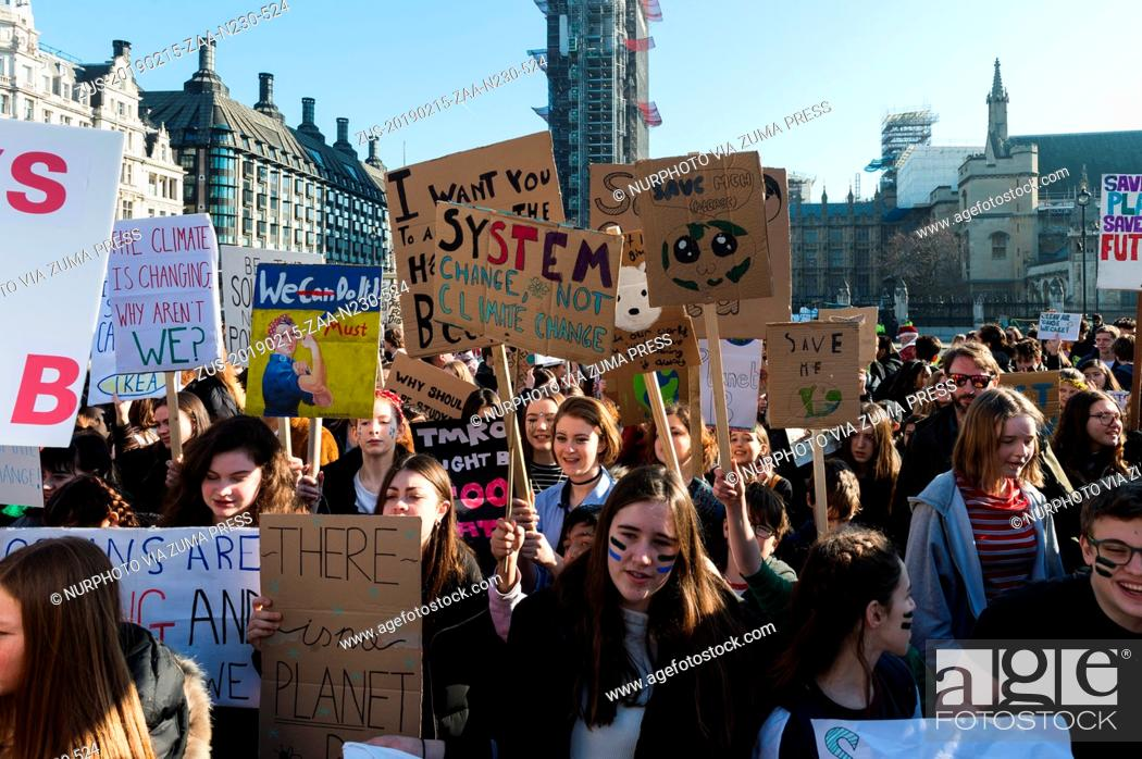 Stock Photo: February 15, 2019 - London, England, United Kingdom - Thousands of young people gather in Parliament Square in central London to protest against the.
