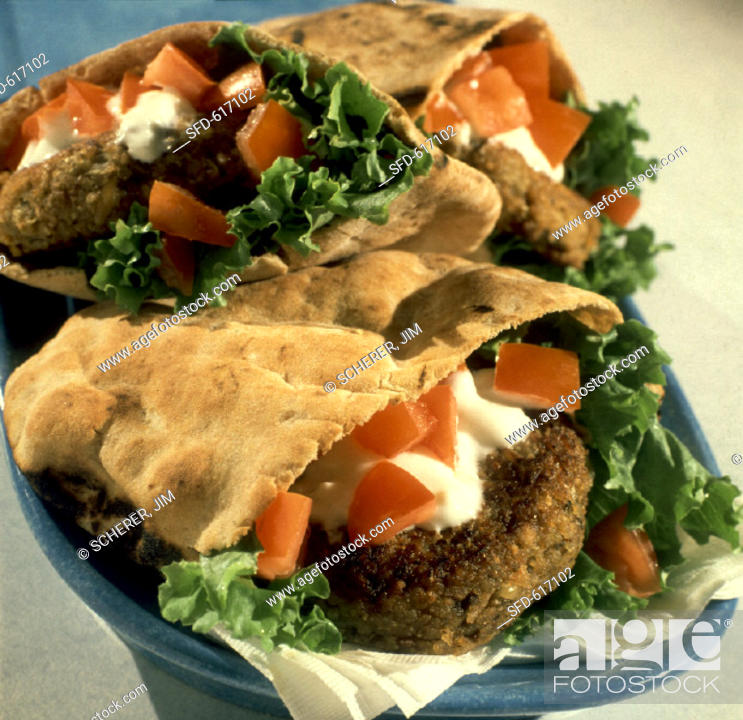 Stock Photo: Falafel Burger in Pita with Tomatoes, Yogurt.