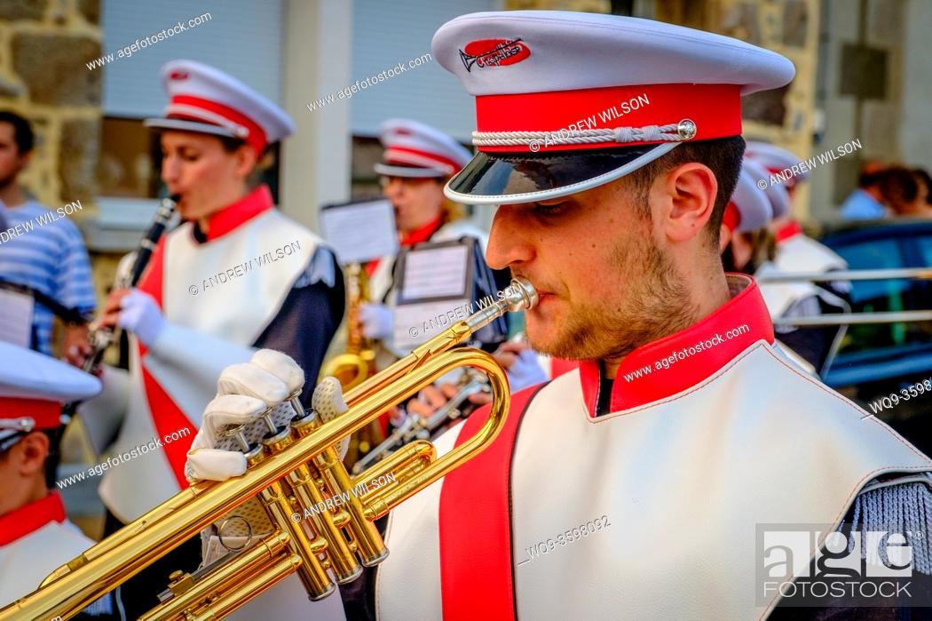Stock Photo: A trumper player in the town band plays during Bastille Day celebrations in the town of Villaines-la-Juhel, Pays de la Loire, France.