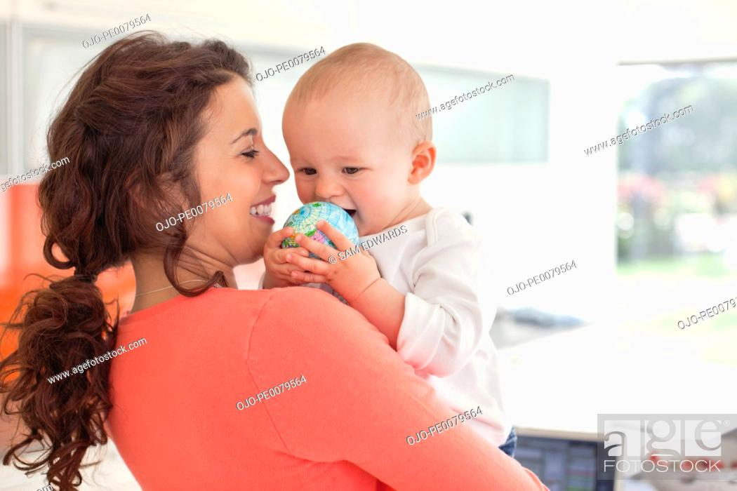 Stock Photo: Mother holding baby.