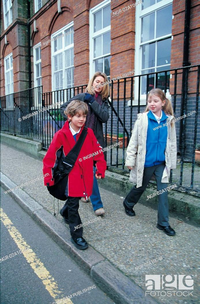 Stock Photo: Kids going to school with mother.