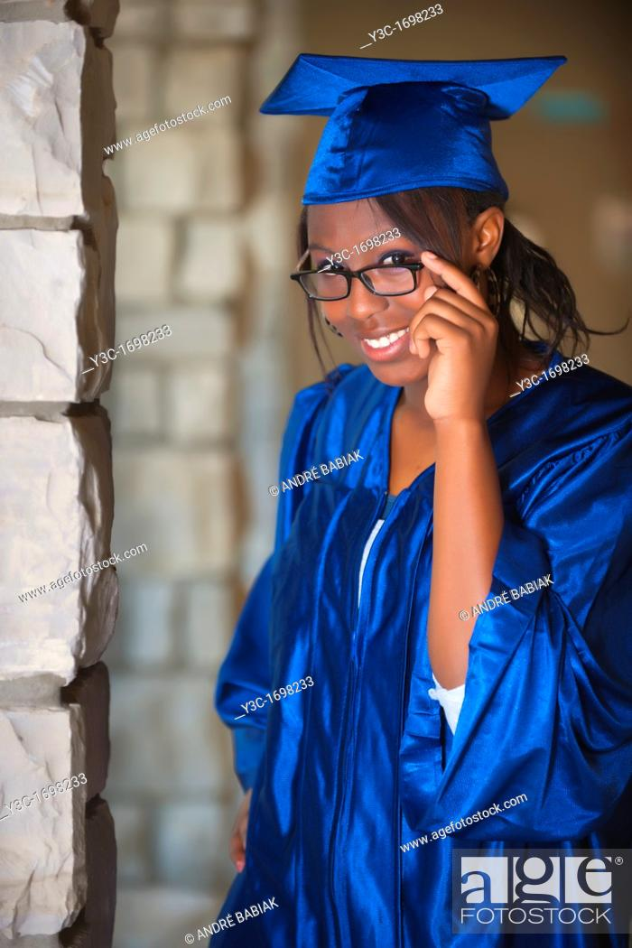 Stock Photo: Female African American Student Portrait in Graduation Outfit on College Campus.