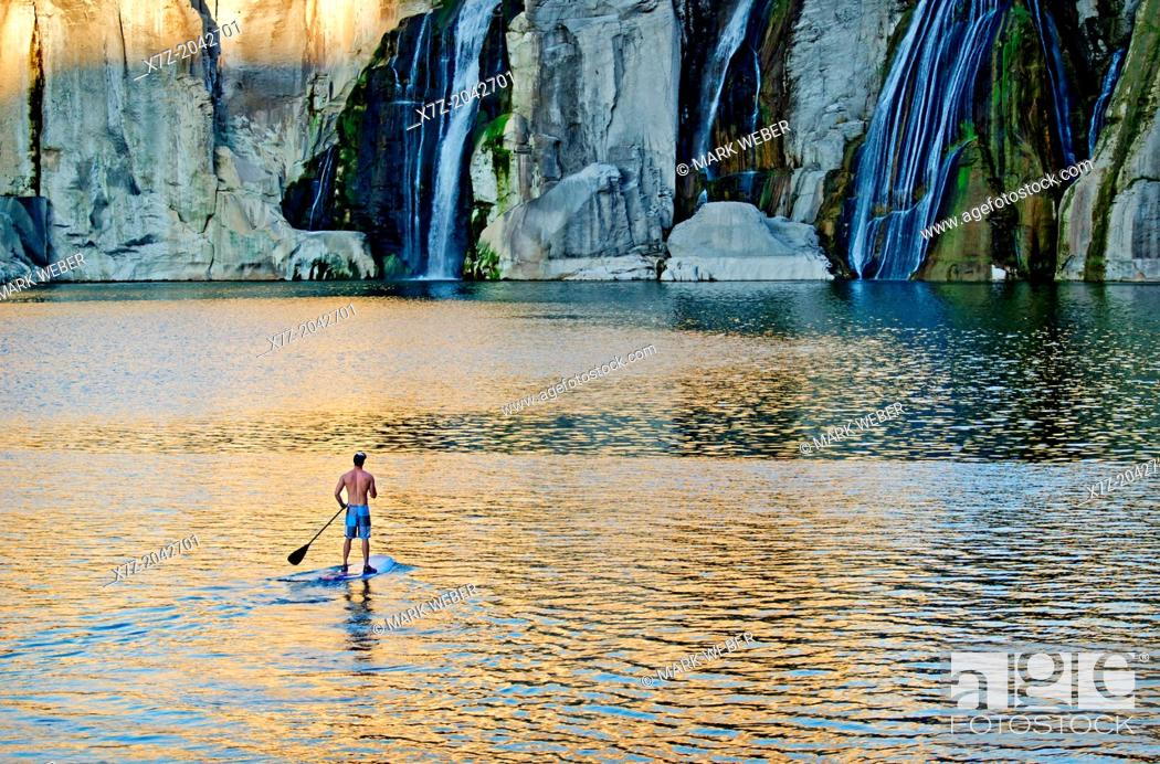Stock Photo: Riding the Stand Up Paddle Board at Shoshone Falls on the Snake River in the Snake River Canyon near the city of Twin Falls in southern Idaho.