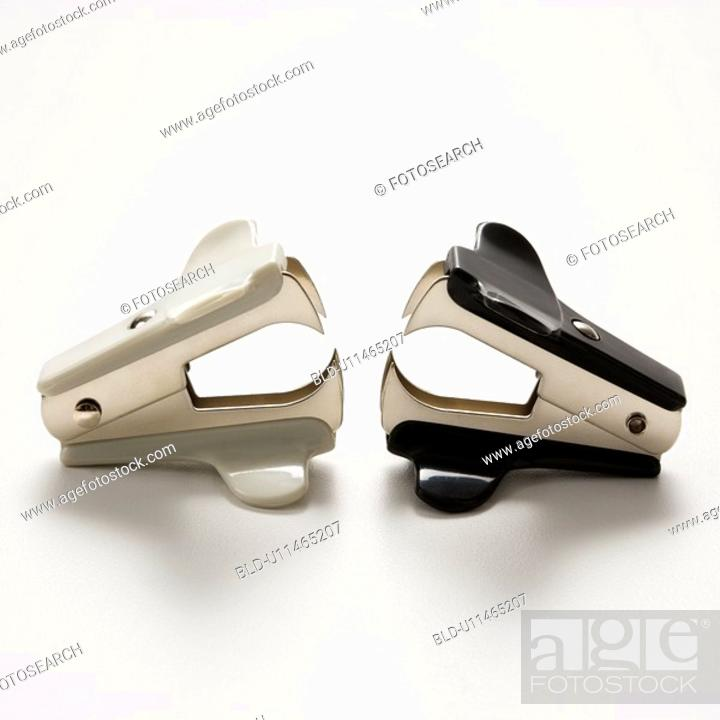 Stock Photo: Two staple removers on white background.