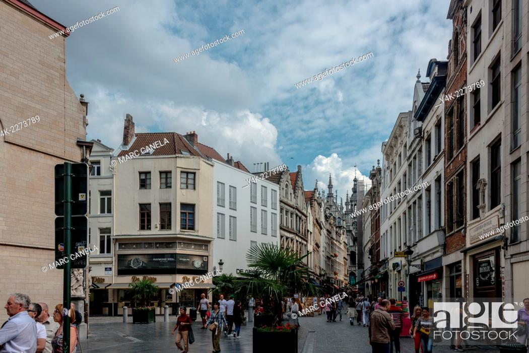 Stock Photo: The Grand Place or Grote Markt is the central square of Brussels. It is surrounded by guildhalls, the city's Town Hall, and the Breadhouse Maison du Roi.