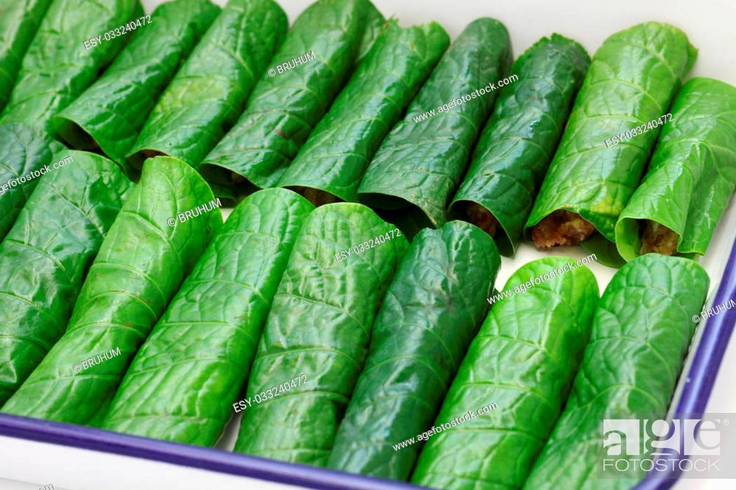 Stock Photo: grilled minced beef wrapped in betel leaf, vietnamese cuisine, thit bo nuong la lot.