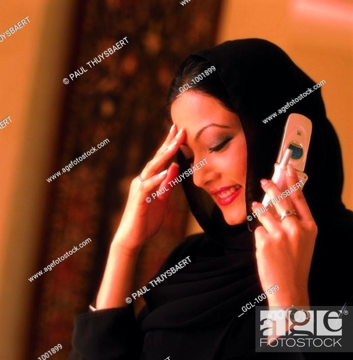 Stock Photo: Arab woman using a cell phone.