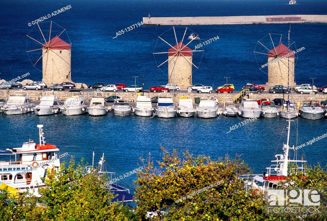 Stock Photo: Windmills in Mandraki harbour Rhodes city, Rhodes Island, Greece.