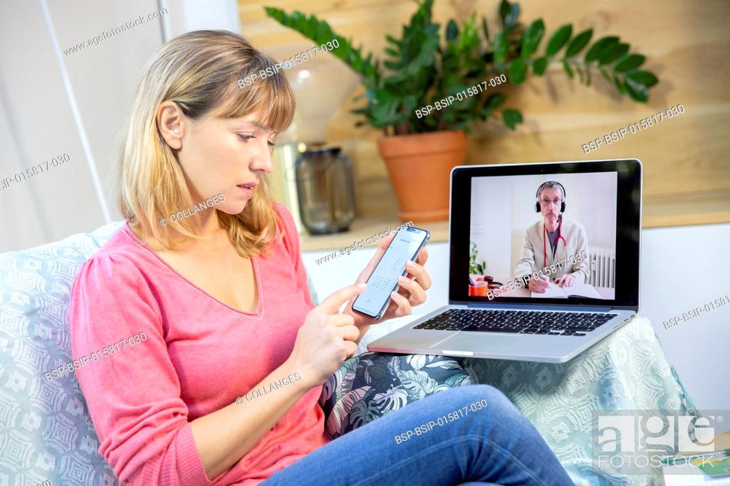 Stock Photo: A video consultation between a young woman and her GP with test results on her mobile.