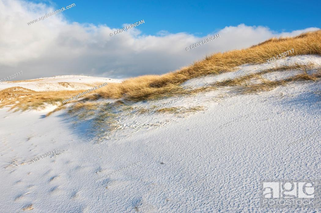 Stock Photo: Snow covered sand dunes and grass, Isle of Harris, Scotland.
