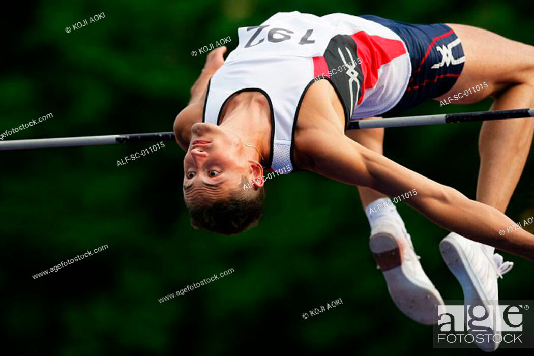 Stock Photo: Male High Jumper Clearing the Bar.