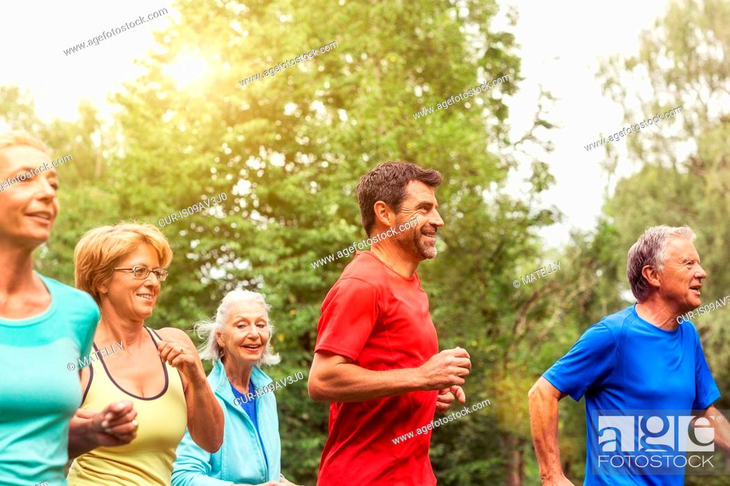 Stock Photo: Group of adults running outdoors.