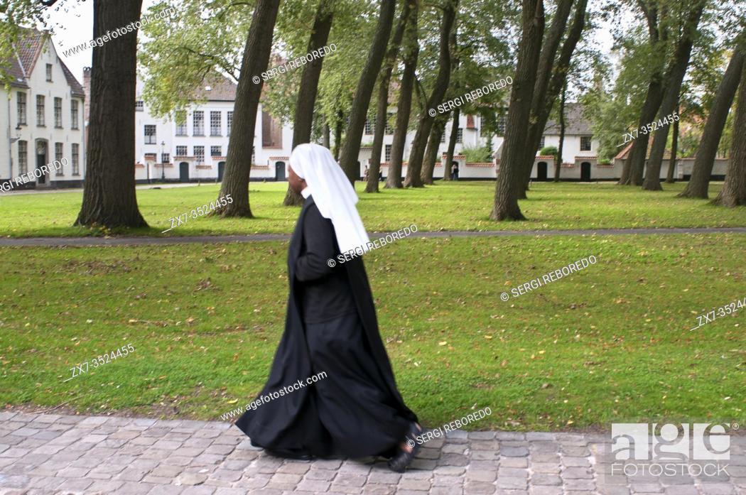 Stock Photo: Nun at Beguinage De Wijngaard, Bruges, Belgium. Now a monastery of Benedictine sisters.