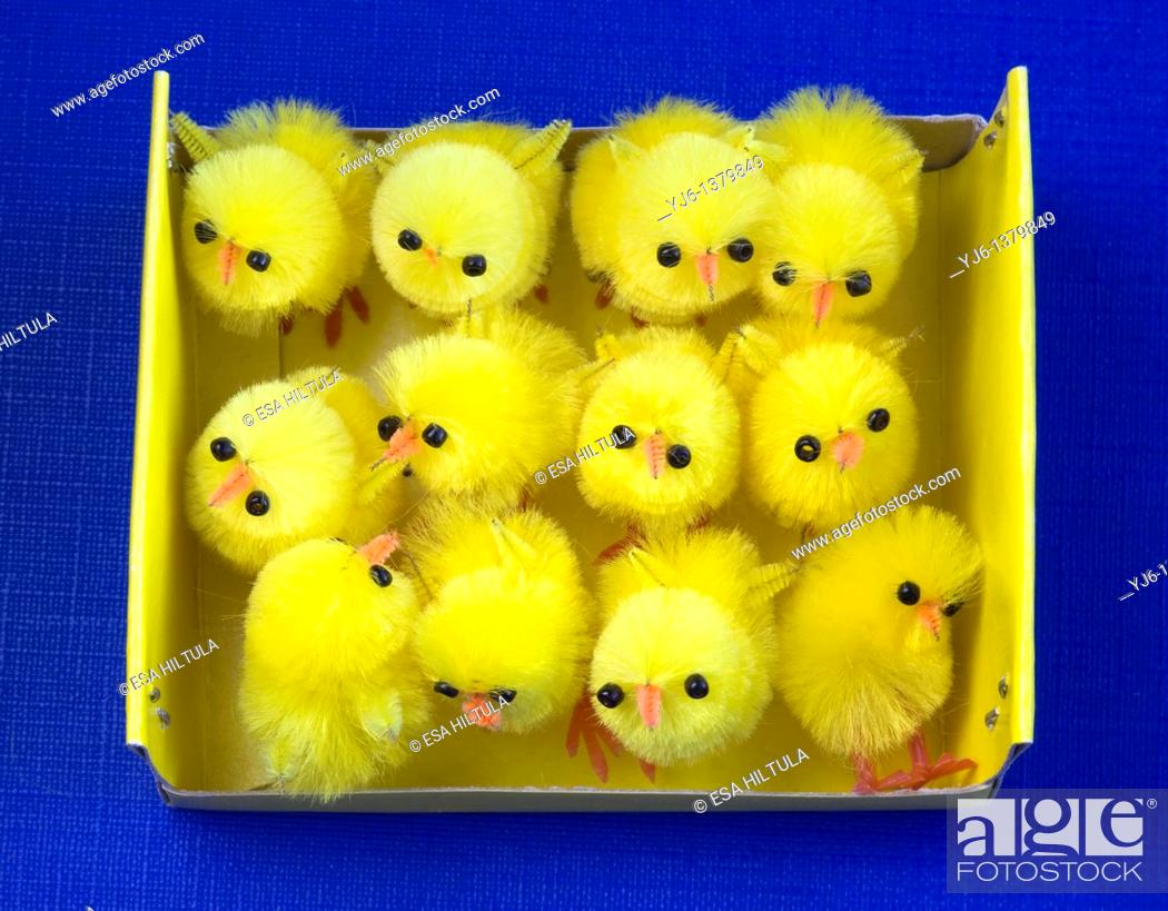 Stock Photo: Easter decoration chickens in a box.