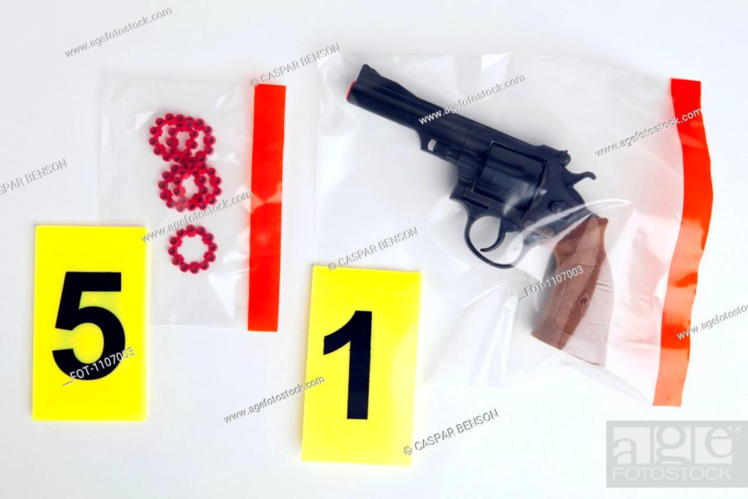 Stock Photo: A BB Gun and BB cartridges in evidence bags.