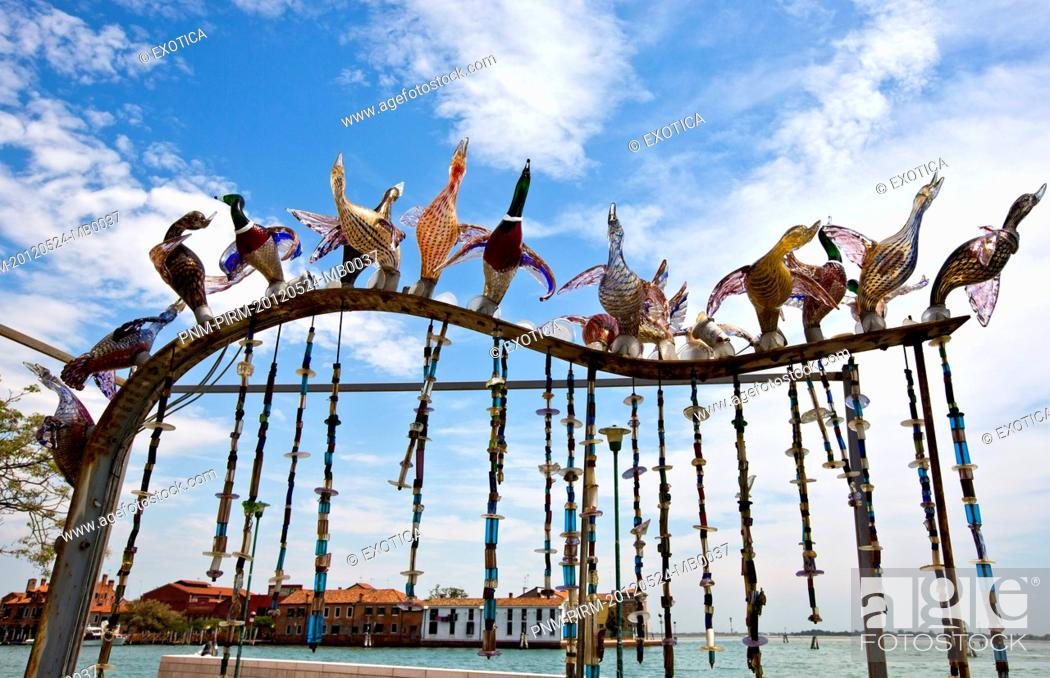 Photo de stock: Low angle view of sculptures with buildings in the background, Murano, Venetian Lagoon, Venice, Veneto, Italy.