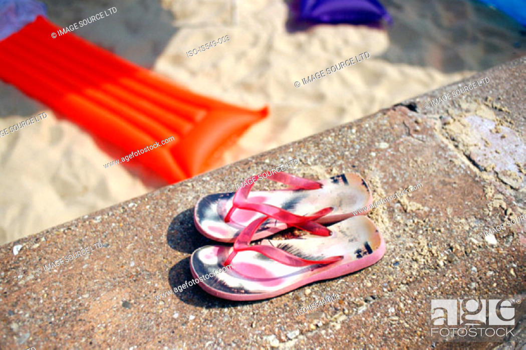 Stock Photo: Flip-flops on the beach.