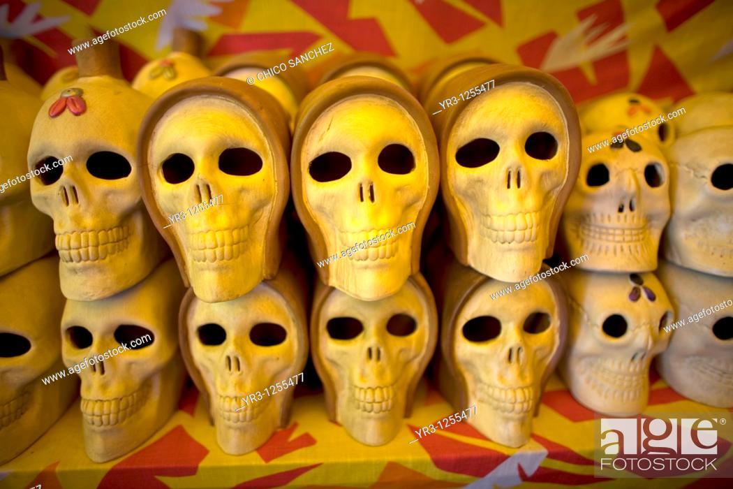 Stock Photo: Smiling ceramic skulls for sale in Mexico City.