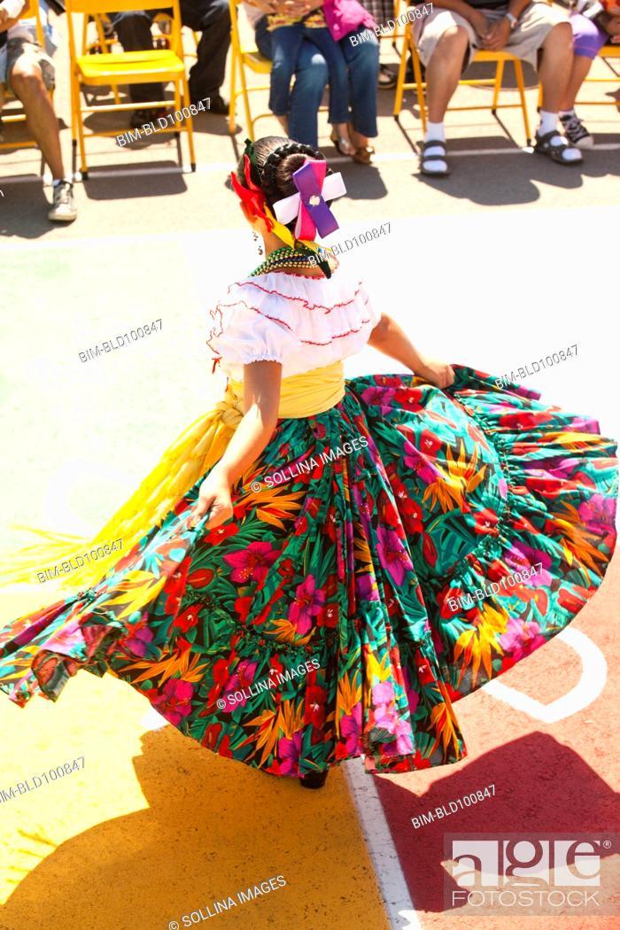 Stock Photo: Hispanic girl in costume dancing.