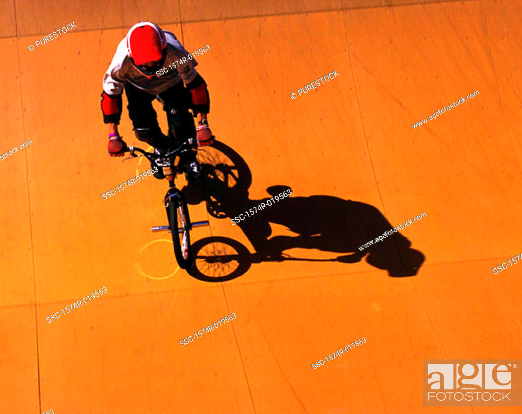 Stock Photo: High angle view of a man riding a bicycle.