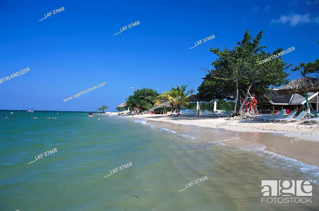 Stock Photo Beach With Sunloungers Under Blue Sky Club Ritz Charlton Rose Hall Montego Bay Jamaica Caribbean America