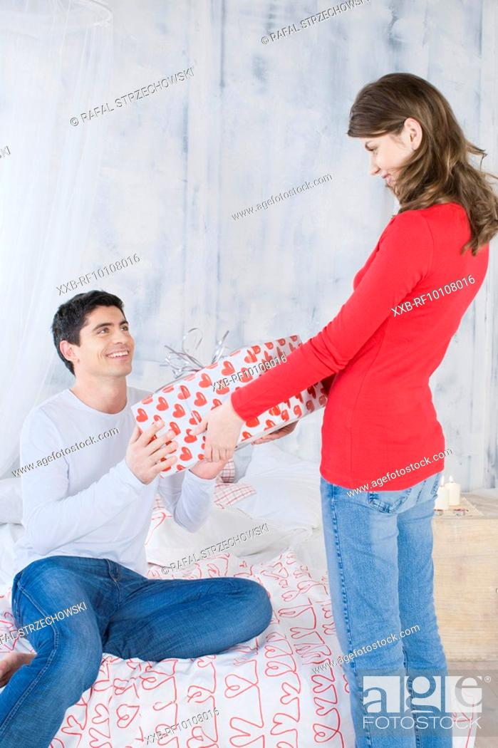 Stock Photo: Woman giving man a present.