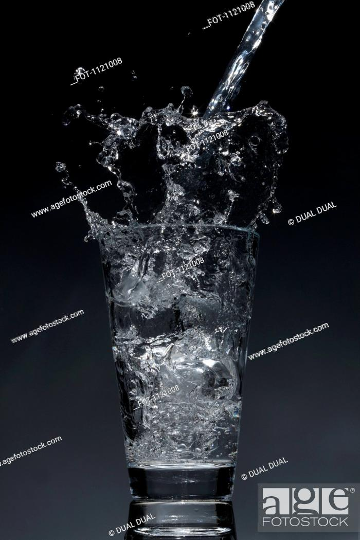 Stock Photo: Water being poured into a glass.