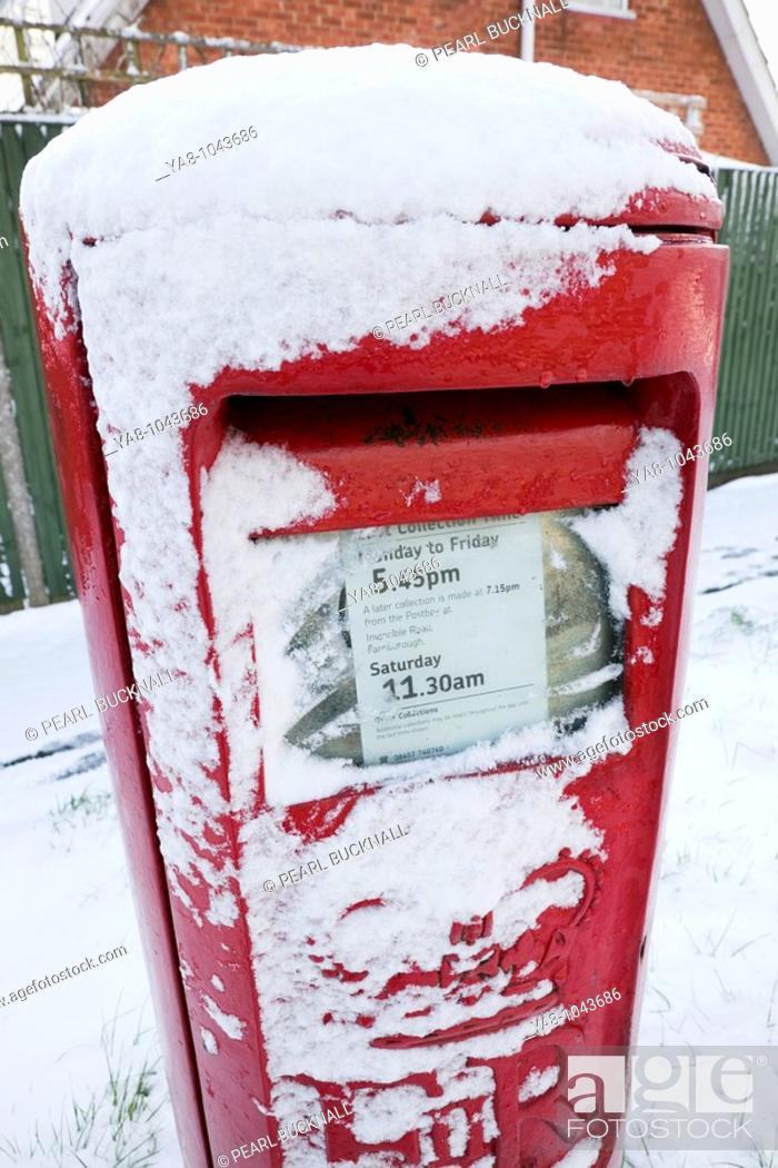 Stock Photo: Britain, UK, Europe  Red postbox covered in snow.