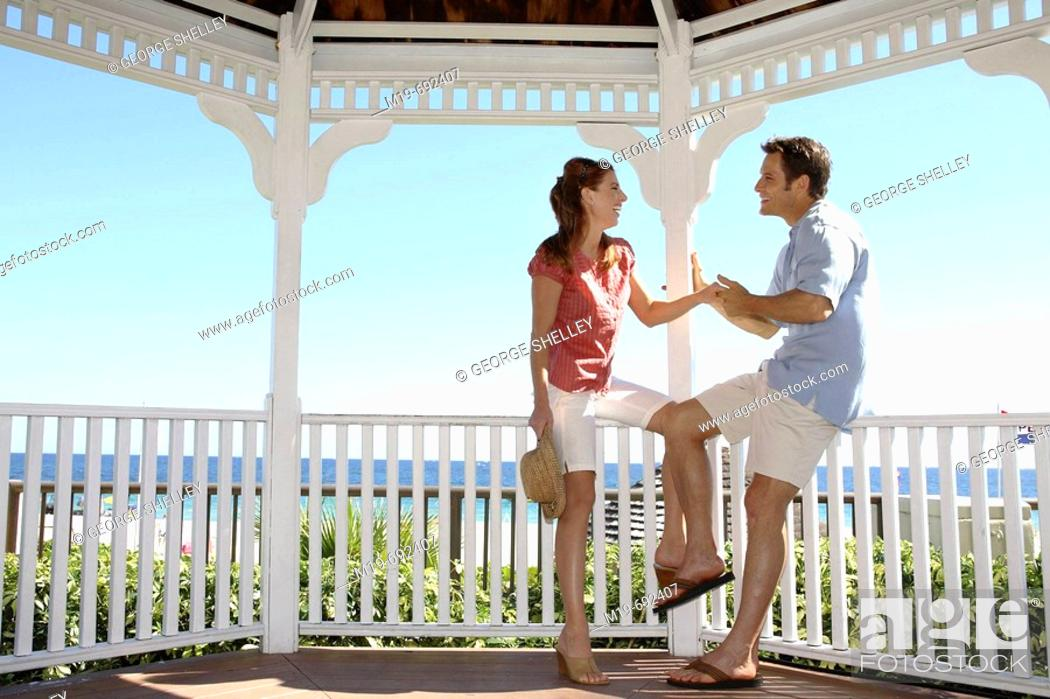 Stock Photo: Couple holding hands in a Gazebo.