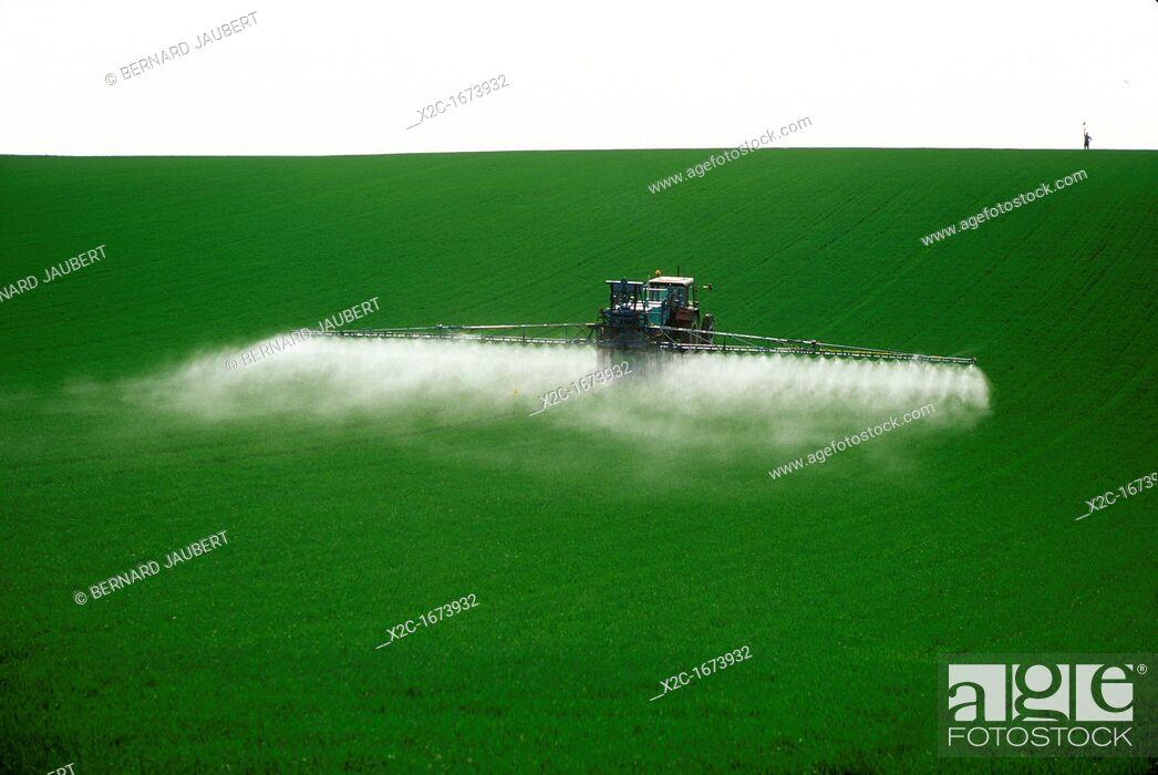 Stock Photo: Spraying fertilizer on crops . France.