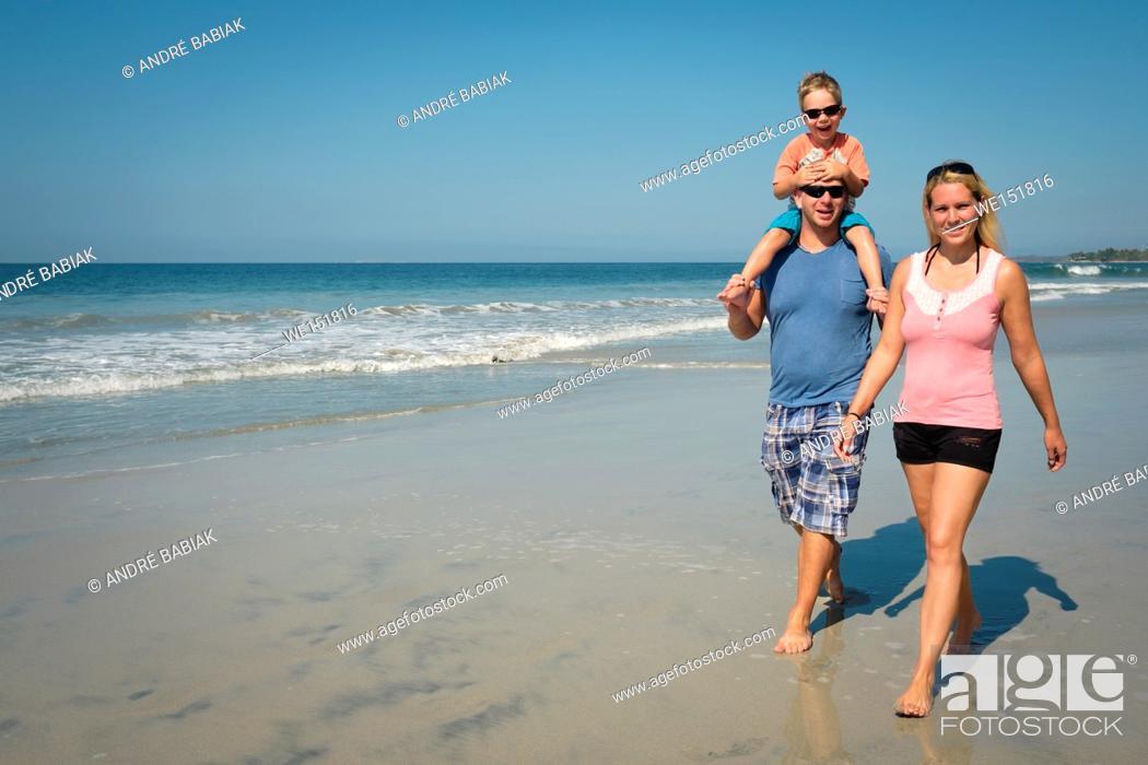 Stock Photo: Family of 3 enjoying walk on the beach, Riviera Nayarit, Mexico.