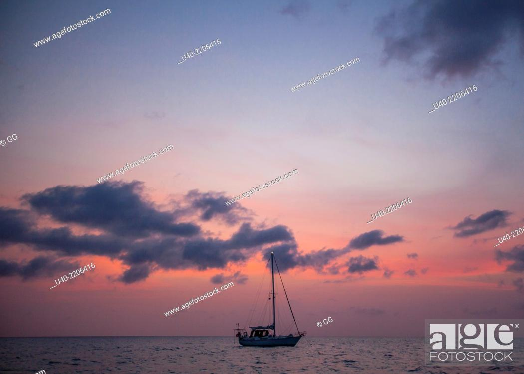 Stock Photo: Belize, sailboats on the Caribbean at Sunset.