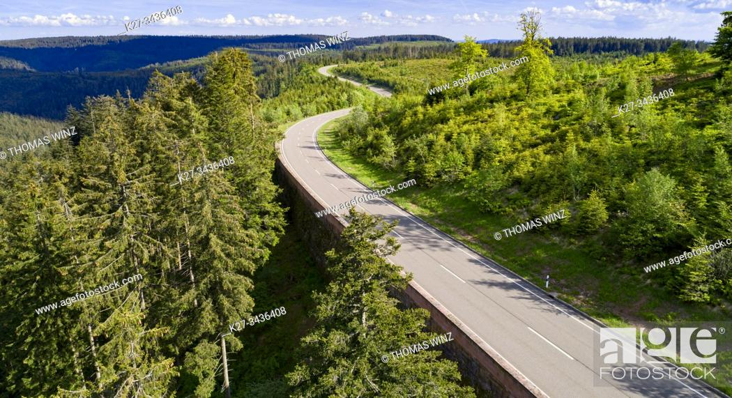 Stock Photo: Curving highway through a forest in springtime from above. Black forest region, Germany.