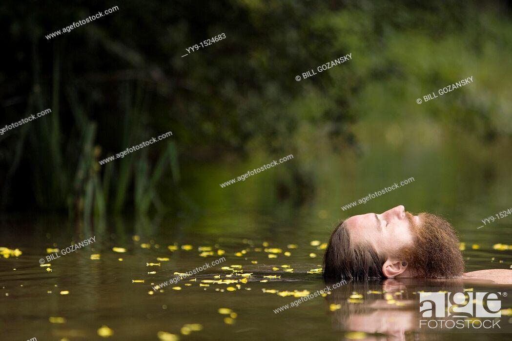 Stock Photo: Head of Bearded Man floating in lake - Cedar Mountain, North Carolina USA.