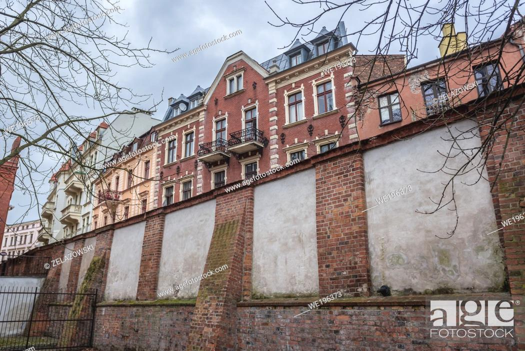 Stock Photo: View from moat of the Teutonic Castle in Old Town of Torun, Kuyavian Pomeranian Voivodeship of Poland.