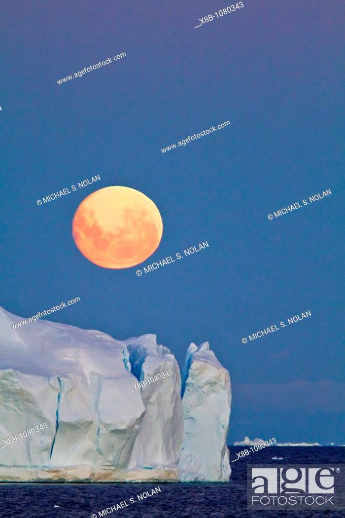 Stock Photo: Full moon plus 1 day rising over icebergs in the Weddell Sea, Antarctica  MORE INFO This moonrise occurred on January 1, 2010.