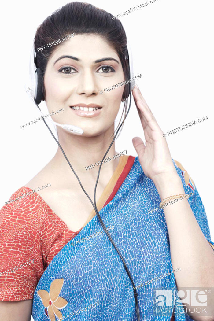Stock Photo: Portrait of a young woman wearing a headset.