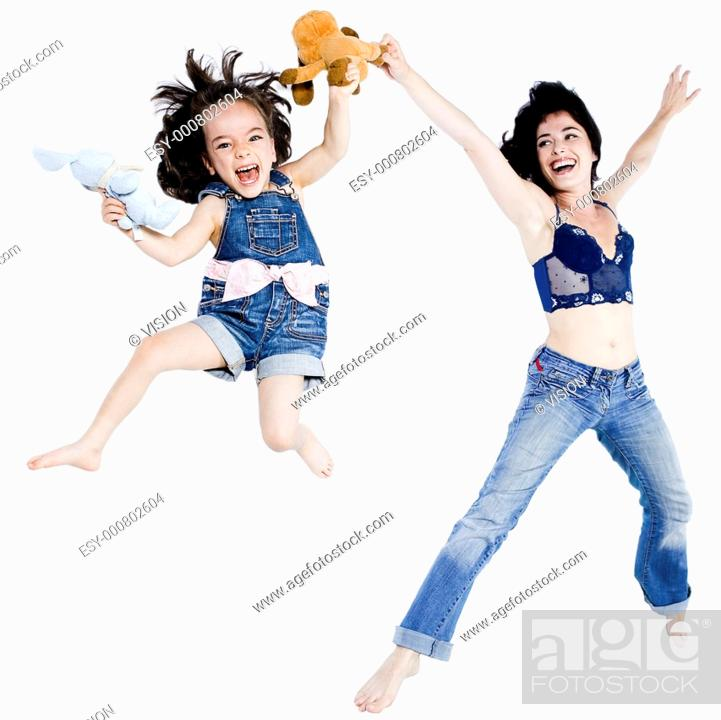 Stock Photo: beautiful woman playing with her little girl on studio white background.