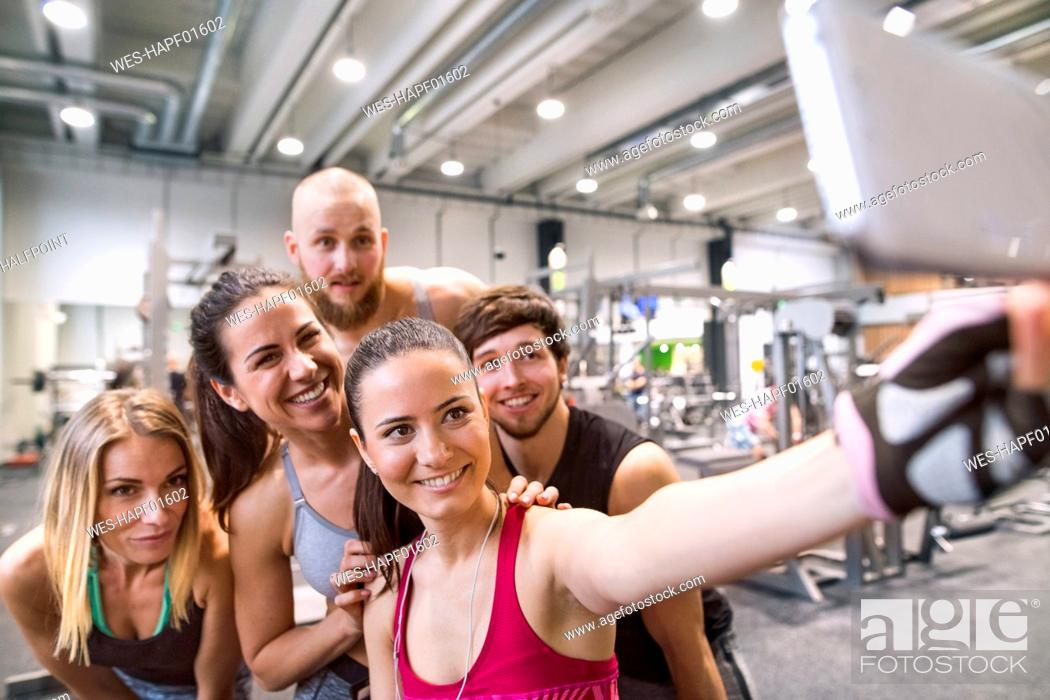 Stock Photo: Young athletes having fun in the gym, taking selfies.