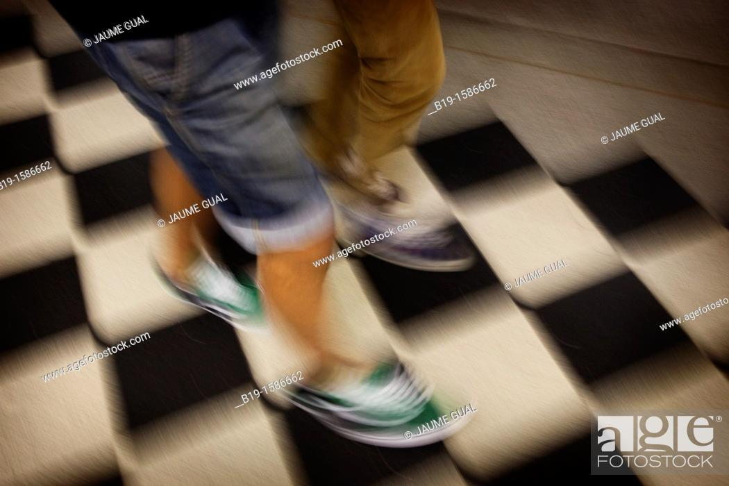 Stock Photo: Two people walkig.