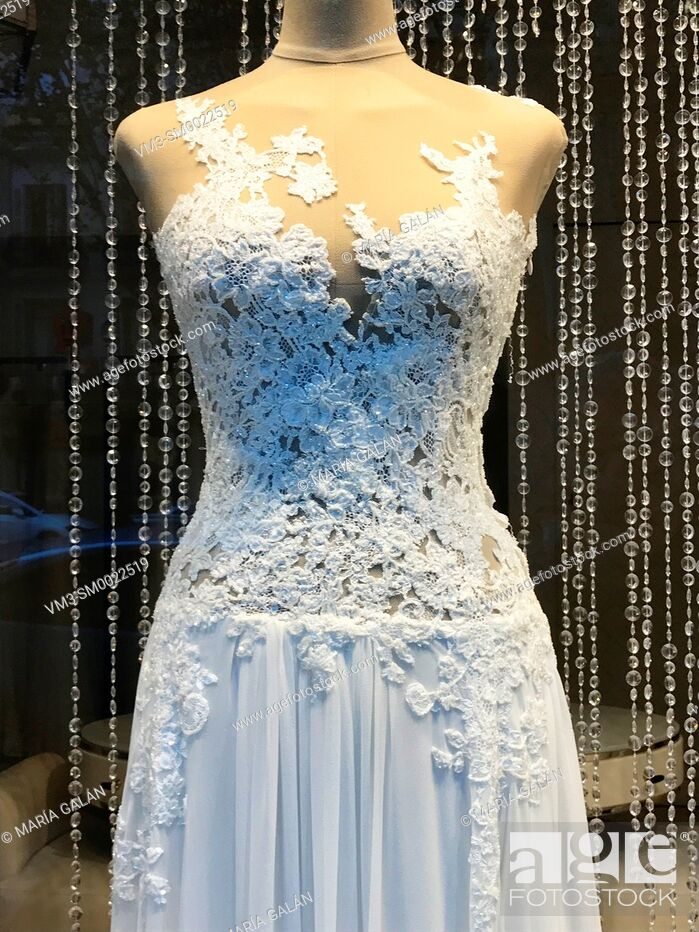 Stock Photo: Wedding dress in a shop window. Madrid, Spain.