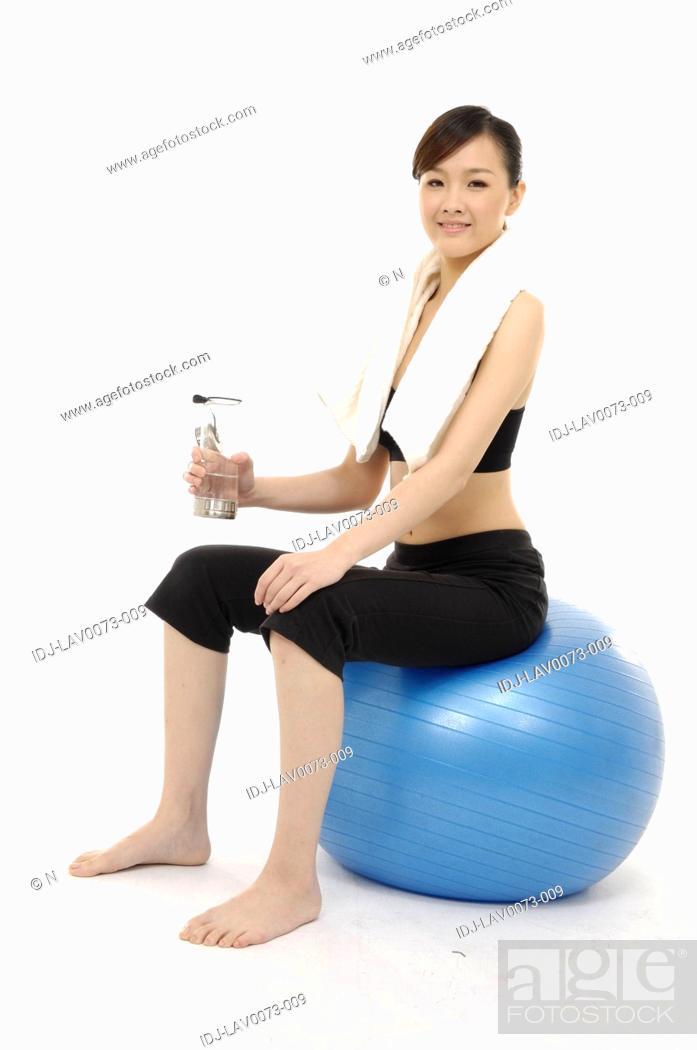 Stock Photo: Woman Sitting on Exercise Ball.