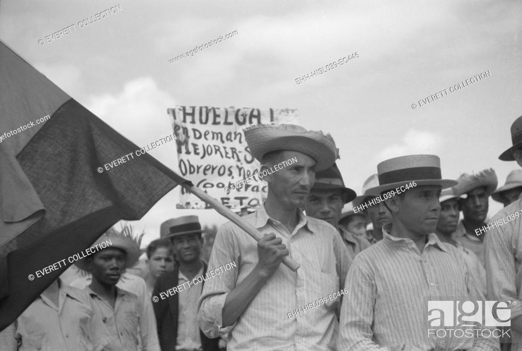Stock Photo: Puerto Rican strikers picketing near the sugar mill where they worked. Yabucoa Municipality, Jan. 1942. - (BSLOC-2015-1-169).