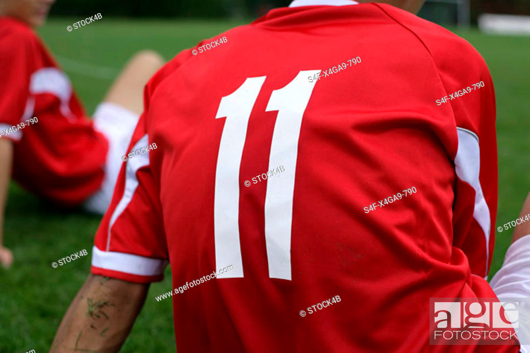 Stock Photo: Soccer player wears number 11 sitting on grass.