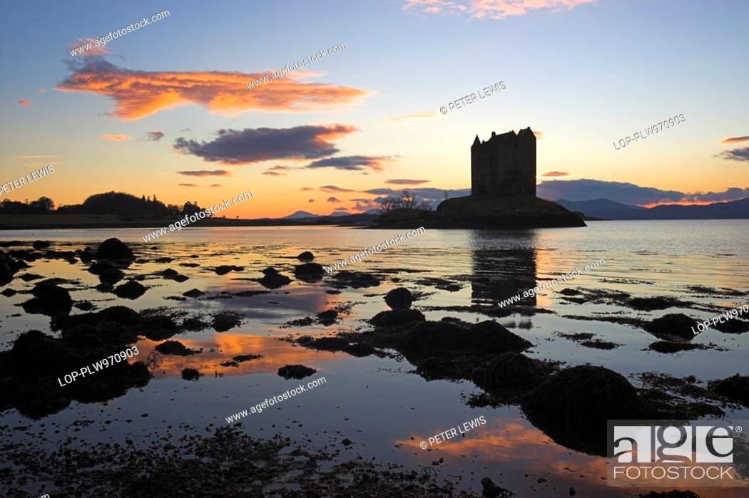 Stock Photo: Scotland, Argyll and Bute, Port Appin, Sunset behind Castle Stalker, one of the best-preserved medieval tower-houses surviving in western Scotland.